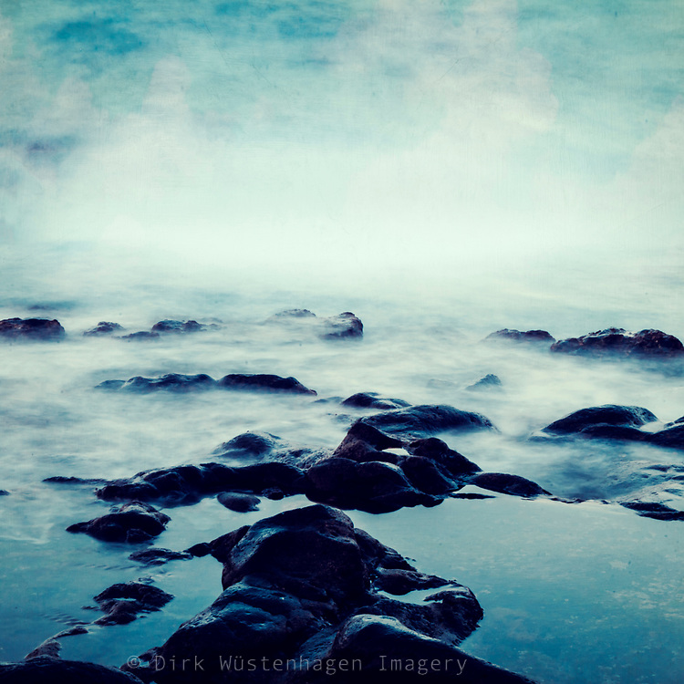 Long exposure of waves over lava rocks - texture dphotograph