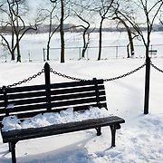Snow covers a park bench on the banks of the Tidal Basin in Washington DC after a winter snow storm.