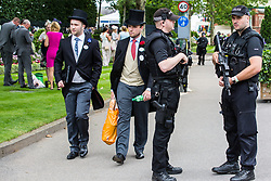 Ascot, UK. 20 June, 2019. Racegoers wearing morning dress attend Ladies Day at Royal Ascot amid tight security.