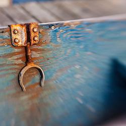 An oar lock on a skiff docked in Wellfleet Harbor in Wellfleet, Massachusetts. Cape Cod.