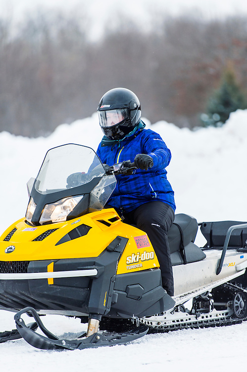 Participants in the Michigan DNR Becoming an Outdoors Woman program learn snowmobiling at Bay Cliff Health Camp in Big Bay, Michigan.