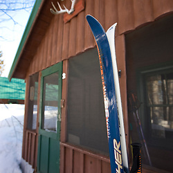 Skis in the snow outside a cabin at Medawisla Wilderness Camps near Greenville, Maine.