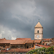 Campanile a Capoliveri, antico borgo dell'Isola d'Elba..Bell Tower in Capoliveri, an ancient village on Elba Island.