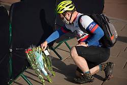 **Caption correction - Pictures taken today 11/04/2021**<br /> © Licensed to London News Pictures.11/04/2021. London, UK. A cyclist places flowers outside Buckingham Palace. On Friday the 9th of April Buckingham Palace announced that Prince Philip The Duke of Edinburgh passed away in the morning at Windsor Castle . Photo credit: George Cracknell Wright/LNP