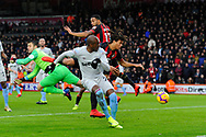 Lukasz Fabianski (1) of West Ham United leapes from his goal line to punch the ball as Nathan Ake (5) of AFC Bournemouth heads the ball in to the goal but has thr goal ruled out during the Premier League match between Bournemouth and West Ham United at the Vitality Stadium, Bournemouth, England on 19 January 2019.