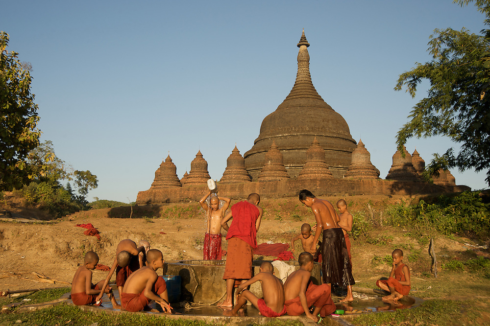 Monks gather around the well for an afternoon wash near their monastery in Mrauk U, Myanmar.