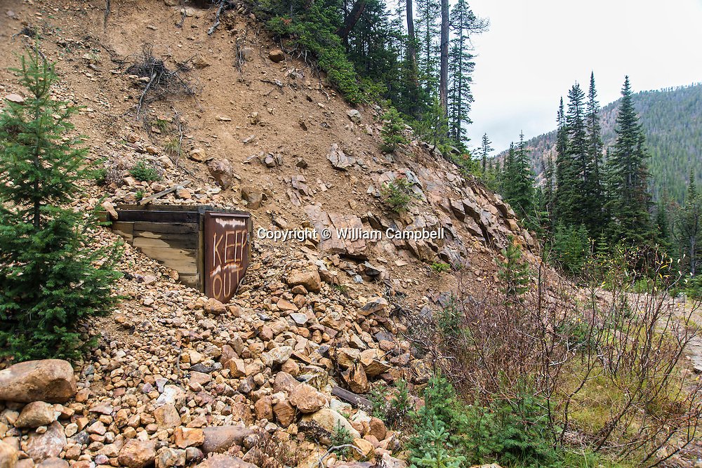 Narrow, unmaintained, old  mining road and abandoned gold mine shaft in the historic St. Julian mining district. Gold was mined here from 1887 until the early 1900's. Scars from the mining remain today.