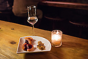 Duck-fat-washed mescal with crispy duck skin and blood oranges.