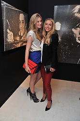 Left to right, FRANCESCA HAMMERSTEIN and LUCINDA EDWARDS at a private view of Russell Young's work entitled American Envy held at Scream Gallery, 34 Bruton Street, London on 7th April 2011.