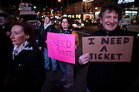 Cheryl Levenbrown, center, outside hoping for tickets while Bruce Springsteen and the E Street Band performs at the Apollo in New York...Photo by Robert Caplin.