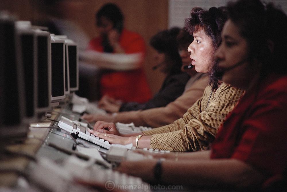 Information operators at Telefonicas Mexicanas. Gabriela Nazario M. answers a call. Mexico City, Mexico.