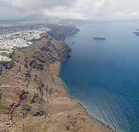 Aerial view of traditional white houses and bay, Santorini island, Greece.
