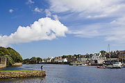Man looks over at Stornoway harbour, Outer Hebrides, United Kingdom