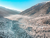 Early morning aerial view of snow-covered Manali city in Himachal Pradesh state in North of India.