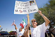 """01 MAY 2006 - PHOENIX, AZ: BENJAMIN CAMPOS, an immigrant from Mexico whose daughter is in the US Army was one of about 1000 immigrants who pickted a street corner in Phoenix near a Home Depot store during a protest in favor of immigration reform during the """"Day without Immigrants"""" protest in Phoenix. About 1,000 people picketed the corner, which had been a popular gathering spot for day laborers until Home Depot took action to keep day laborers off their property. Immigrants rights groups picketed two Home Depot stores, a pallet manufacturing plant and a public school during the protest. Photo by Jack Kurtz"""
