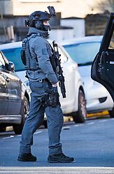 © Licensed to London News Pictures. 22/01/2021. London, UK. An armed Counter Terrorism Specialist Firearm Officer (CTSFO) at a property in Southall, west London where police are currently involved in a standoff with a man, reported to be in possession of a firearm, at a residential address. Photo credit: Ben Cawthra/LNP