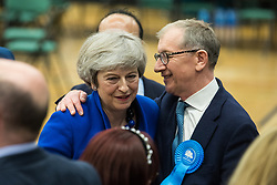 Maidenhead, UK. 13 December, 2019. Former Conservative Prime Minister Theresa May is congratulated by her husband Philip May after being re-elected as the Member of Parliament for the Maidenhead constituency.
