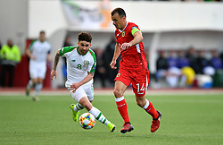 Republic of Ireland's Sean Maguire and Gibraltar's Roy Chipolina (right) battle for the ball during the UEFA Euro 2020 Qualifying, Group D match at the Victoria Stadium, Gibraltar.