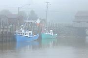 FIshing boats  in fog<br /> <br /> Saint Martins<br /> New Brunswick<br /> Canada