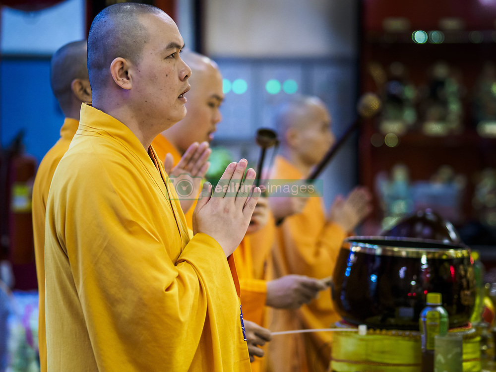 """August 22, 2017 - Bangkok, Bangkok, Thailand - Mahayana Buddhist monks lead a ceremony on the first day of Hungry Ghost Month at the Poh Teck Tung Shrine in Bangkok's Chinatown. The seventh lunar month (August - September) is when many Chinese believe Hell's gate will open to allow spirits to roam freely in the human world. Many households and temples hold prayer ceremonies throughout the month-long Hungry Ghost Festival (Phor Thor) to appease the spirits. During the festival, believers will also worship the Tai Su Yeah (King of Hades) in the form of paper effigies which will be """"sent back"""" to hell after the effigies are burnt. (Credit Image: © Jack Kurtz via ZUMA Wire)"""