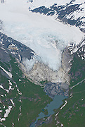 Alaska. Chugach National Forest. Aerial over a glacier showing erosion and global warming as the glacier retreats.