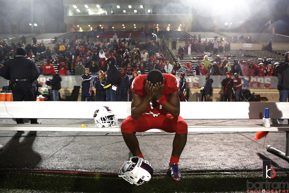 Bishop Dunne's Brian Williams sits on the bench following the TAPPS Division I state championship game on Saturday, Dec. 3, 2016 at Panther Stadium in Hewitt, Texas. Bishop Lynch High School won 21-17. (Photo by Kevin Bartram)