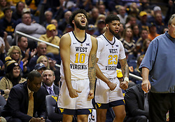 Nov 24, 2018; Morgantown, WV, USA; West Virginia Mountaineers guard Jermaine Haley (10) reacts from the bench during the second half against the Valparaiso Crusaders at WVU Coliseum. Mandatory Credit: Ben Queen-USA TODAY Sports