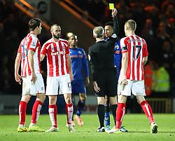 Rochdale's Rhys Bennett receives a yellow card - Photo mandatory by-line: Matt McNulty/JMP - Mobile: 07966 386802 - 26/01/2015 - SPORT - Football - Rochdale - Spotland Stadium - Rochdale v Stoke City - FA Cup Fourth Round