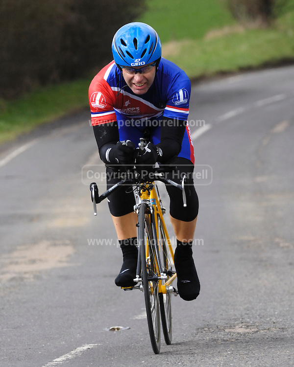 United Kingdom, Finchingfield, Mar 27, 2010:  Kevin Whelan, Bishops Stortford CC, approaches the 4 miles to go marker during the 2010 edition of the 'Jim Perrin' Memorial Hardriders 25.5 mile Sporting TT promoted by Chelmer Cycling Club. Copyright 2010 Peter Horrell.