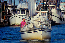 Older woman riding in a sailboat in Galveston Texas