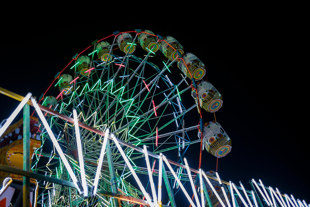 PUSHKAR, INDIA - CIRCA NOVEMBER 2016:  Ferris Wheel in Pushkar at night during the Pushkar Camel Fair.  It is one of the world's largest camel fairs. Apart from the buying and selling of livestock, it has become an important tourist attraction.