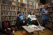 In the final hours before the closure, locals use the facilities of Carnegie Library, in the south London borough of Lambeth on 31st March 2016 in London, United Kingdom. This has angered the local community who have occupied their important resouce for learning and social hub. After a long campaign by locals, Lambeth council have gone ahead and closed the library's doors for the last time at 6pm because, they say, cuts to their budget mean millions must be saved. A gym will replace the working library and while some of the 20,000 books on shelves will remain, no librarians will be present to administer it. London borough's budget cuts mean four of its 10 libraries will either close, move or be run by volunteers.