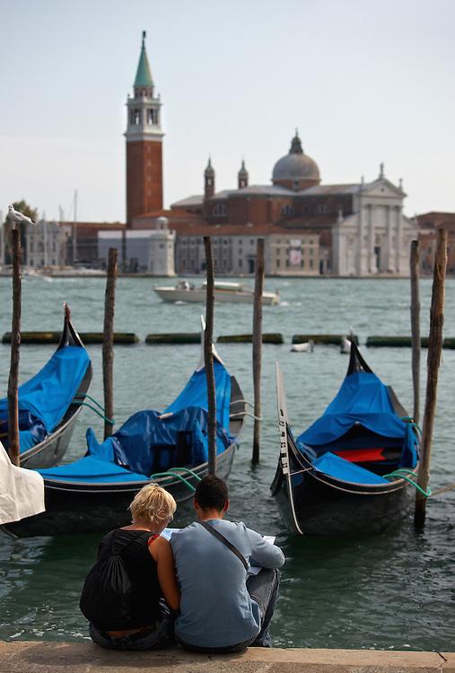 Italy - Venezia - Man, woman, gondolas, island