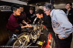 Harley-Davidson's design team talking with Hideki Hoshikawa of Asterisk Motorcycles, the recipient of their Harley-Davidson award, at the Annual Mooneyes Yokohama Hot Rod and Custom Show. (L>R) Hideki Hoshikawa, Dais Nagao, Charlie Wartgow, Ben McGinley and head of design Ray Drea. Japan. Sunday, December 7, 2014. Photograph ©2014 Michael Lichter.