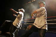 """A Krumping crew on stage..Battlezone 2005 held at the Great Western Forum in Inglewood, CA. Krumpers and Clown dancers from South Central LA showcase their dancing skills in a yearly competition. Tommy Johnson, aka """"Tommy the Clown"""" started the Clown dance and Krumping movement in South Central LA as a real alternative to gangs and crime. The high energy Krumping and Clown dancing are hip hop based with African tribal dancing tributes. Face paint is often worn to distinguish the dancers unique dance styles, most are clown like with graffiti accents. The dance movement was made popular by the recent documentary """"Rize"""" by photographer David LaChappelle which featured """"Tommy The Clown"""".."""