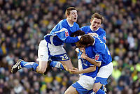 Photo: Chris Ratcliffe.<br />Norwich City v Ipswich Town. Coca Cola Championship. 05/02/2006.<br />Jimmy Juan of Ipswich is mobbed by Scott Barron (L) and Darren Currie (R) after scoring from a free kick.
