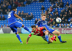 Aron Gunnarsson of Cardiff City battles for the ball with Marlon Pack of Bristol City  - Mandatory byline: Joe Meredith/JMP - 07966 386802 - 26/10/2015 - FOOTBALL - Cardiff City Stadium - Cardiff, Wales - Cardiff City v Bristol City - Sky Bet Championship