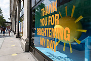 Thank you for brightening my day sign in the window of Selfridges as some non-essential shops re-open, shoppers return to Oxford Street while social distancing measures are put in place by the various retail shops which are open on 26th June 2020 in London, England, United Kingdom. As the July deadline approaces and government will relax its lockdown rules further, the West End remains quiet, apart from this popular shopping district, which itself has far fewer people on its pavements than normal.