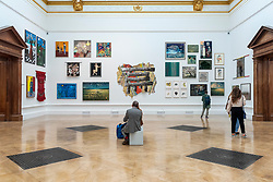 © Licensed to London News Pictures. 15/09/2021. LONDON, UK. A general view of exhibits. Preview of the Summer Exhibition 2021 at the Royal Academy of Arts in Piccadilly. Co-ordinated by Yinka Shonibare RA, the exhibition explores the theme of 'Reclaiming Magic' to celebrate the joy of creating art with around 1400 works by emerging and established artists featured in the exhibition.  The Summer Exhibition is the world's largest open submission contemporary art show and has taken place every year without interruption since 1769.  Photo credit: Stephen Chung/LNP