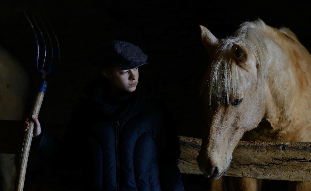 Jade Labeste with horse in the stables of the Priory of Sacquenay.