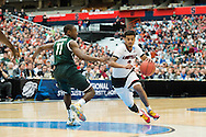 29 MAR 2015: Quentin Snider (2) of the University of Louisville drives in to the paint against Lourawis Nairn Jr. (11) of Michigan State University during the 2015 NCAA Men's Basketball Tournament held at the Carrier Dome in Syracuse, NY. Michigan State defeated Louisville 76-70 to advance. Brett Wilhelm/NCAA Photos