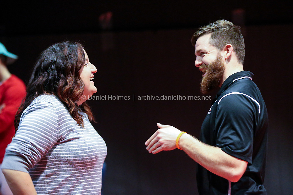 (1/9/19, ASHLAND, MA) Hopkinton assistant coach Tommy Karner and his sister Jessie Karner, 12-year Hopkinton wrestling manager, talk during the Coaches vs. Cancer wrestling match at Ashland High School on Wednesday. [Daily News and Wicked Local Photo/Dan Holmes]