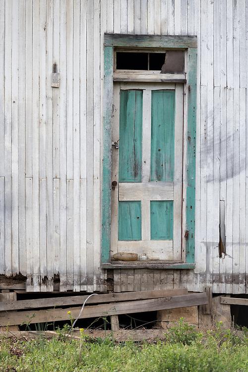An old door on an old farmhouse, near Trenton, Alabama.