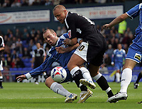 Photo: Paul Thomas.<br /> Oldham Athletic v Swansea City. Coca Cola League 1. 12/08/2006.<br /> <br /> Lee Trundle (R) of Swansea tries to get past Simon Charlton.