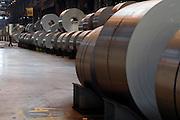 Lamiere d'acciaio arrotolate in bobine, all'interno di un reparto dell'impianto siderurgico ILVA di Taranto. Taranto, 6 giugno 2008. Christian Mantuano / OneShot
