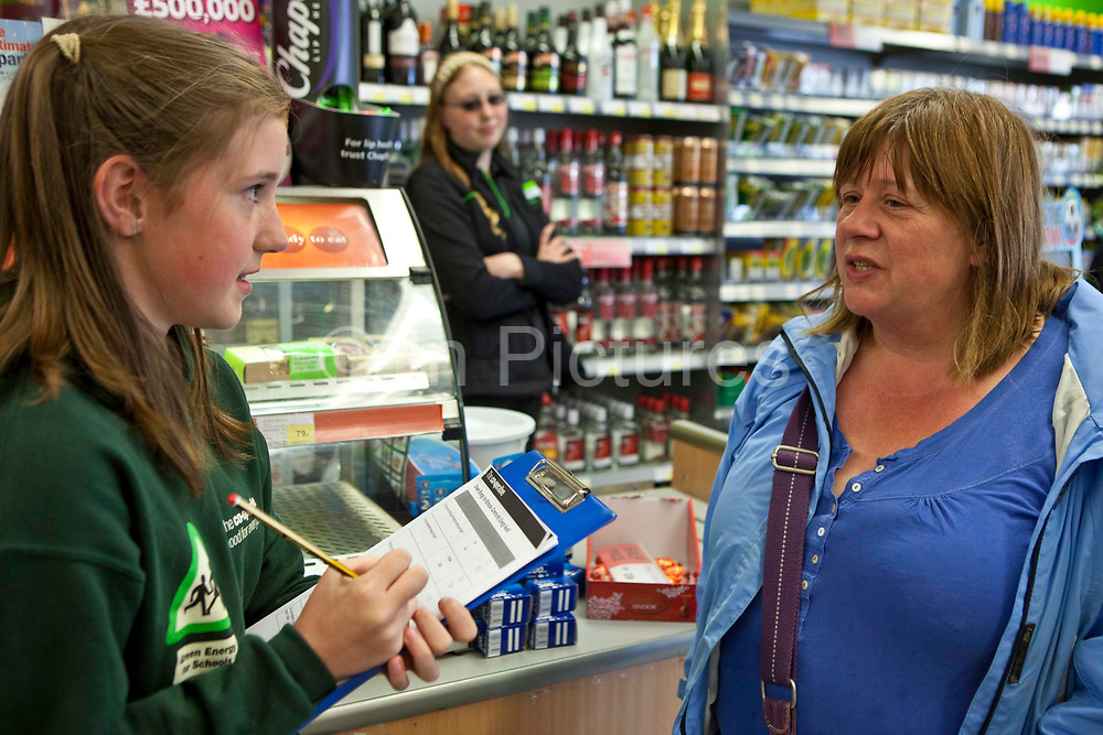 A pupil from the St. Columb Minor school in Cornwall, completes a community energy survey by talking to customers in the local Co-Operative supermarket. The school won an Ashden Award in 2010 for it's appraoch to sustainable energy.