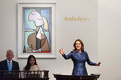 © Licensed to London News Pictures. 19/06/2018. LONDON, UK.  Helena Newman, Chairman, Sotheby's Europe, manages bids for ''Buste De Femme De Profil (Femme Écrivant)'' by Pablo Picasso, which sold for a hammer price of £24,000,000, below its estimate of £33,000,000, at Sotheby's Impressionist & Modern art evening sale in New Bond Street.  Photo credit: Stephen Chung/LNP
