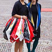 NLD/Den Haag/20130917 -  Prinsjesdag 2013, Esther Ouwehand  met dame die jurk draagt van plastic zakken
