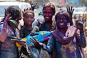 Indian people celebrate Hindu Holi festival of colours with powder paints in Mumbai, India