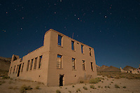 Moonlit ruins of the school building in the ghost town of Rhyolite, Nevada, a mining boomtown that, at its peak between 1905 and 1912, had a population of 5,000 to 10,000.